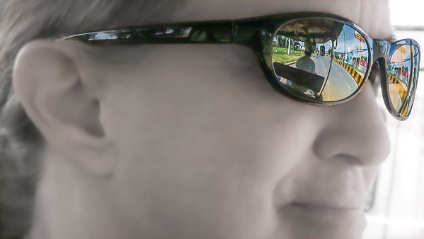 A reflection of our first Cambodian tuk-tuk ride from the airport into central Phnom Penh.