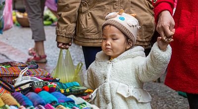 This young woman is a very discerning shopper in the Luang Prabang morning market.