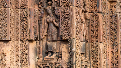 Keeper of the Clouds and the Waters, an apsara graces the carved sandstone columns of Banteay Srei, a Hindu temple in Angkor.