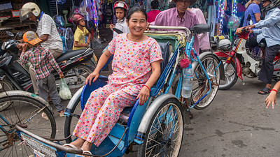 Pajamas are always fashionable at the market in Phnom Penh.