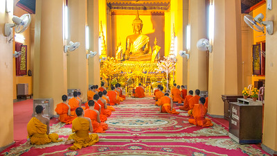 Vientiane has the largest concentration of Buddhist Wats in Laos as well as the largest number of monks.  Here a group of monks are immersed in their evening studies at Wat Inpeng.