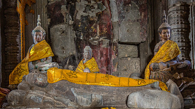 Buddhist deities and a reclining Buddha draped in gold cloaks.  Gold is highly revered in Buddhist culture.  It represents the sun which in turn symbolizes knowledge, enlightenment, purity, happiness, and freedom