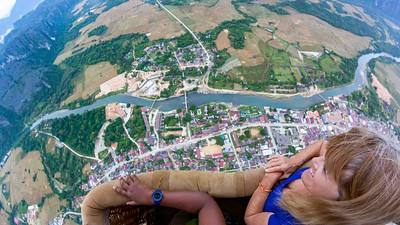 Flying high over Vang Vieng and the Nam Song river Linda checks out the view.