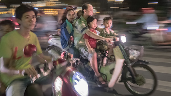 The motor scooter is the mini van of choice in Cambodia.  Here a family of 5 makes its way through the streets of Phnom Penh.