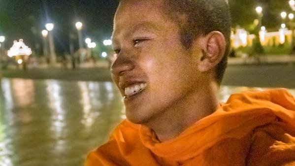 Buddhist monk enjoying the evening along the Mekong River, Phnom Penh, Cambodia
