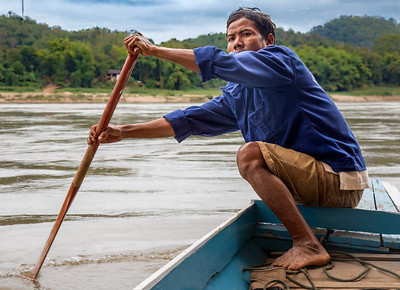 The boatman who rowed Linda and I across the Mekong River to visit the Buddha Caves.  Pak Ou, Laos.