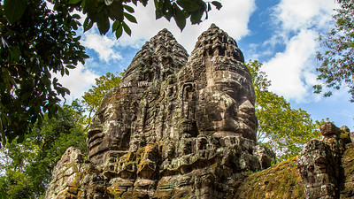 The faces of the Bodhisattva Avalokiteśvara look out over the South Gate of Angkor Thom, Angkor Cambodia