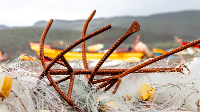 Boat anchors litter the beach in the fishing town of Bucalemu, Chile.