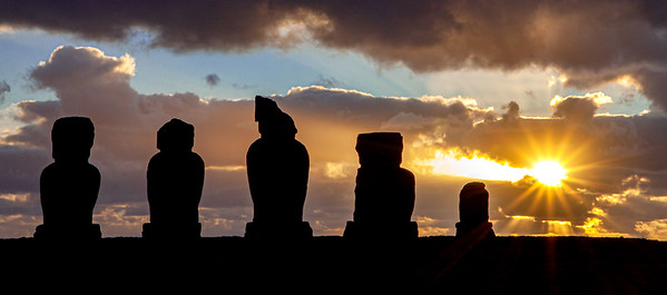 The moai's Ahu Vai Urii silhouetted by the sunset , Hanga Roa, Easter Isalnd