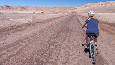 Renting a bicycle in San Pedro de Atacama riding through the Valle de Luna is the only way to truly appreciate the stark barren beauty of the Atacama desert.