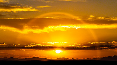 A sun dog around the setting sun looking across the Bonneville Salt flats towards Wendover, Nevada from Knolls, Utah.