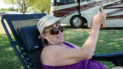 Linda relaxing in Fort Bridger, Wyoming while we take a day off from boon docking to do laundry and just enjoy the luxuries of being in an RV park.