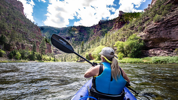 """Linda paddling the """"A"""" section of the Green River.  It is 7 miles from the put in at the Royal Gorge Dam to the Little Hole take out.  7 of the 8 rapids are located along this section of the river."""