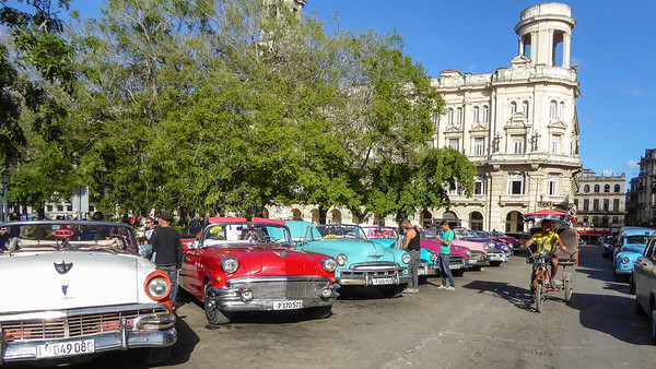 The classic car taxi line up along the Obrapia and the Parque Central in Old Havana.