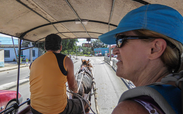 While waiting for a bus connection on our way to Vinales, Linda and I took the opportunity to visit the town of Santa Clara, Cuba.  The bus station is serviced regularly by horse drawn carts that serve as local taxis.