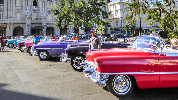 The lineup of taxis for hire outside of the Grand Theater of Havana.  The ultimate lineup of beautiful classic '50s automobiles.