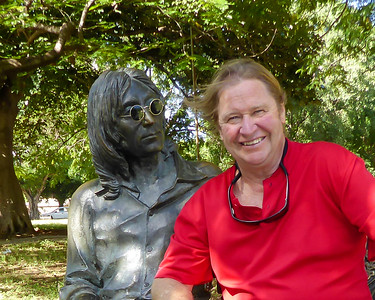 "The Beatles and their music was once banned in Cuba.  Twenty years after John Lennon's death Fidel Castro dedicated a statue of Lennon and dedicated Lennon Park in his honor as a ""fellow dreamer.""  A security guard who watches over the statue puts his glasses on for photo opportunities."
