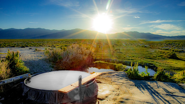 The tub with the best view at Spencer Hot Springs.  The entirity of the Big Smokey Valley stetches out in all directions.  In the evening the Hickison burros always make their way down for a drink