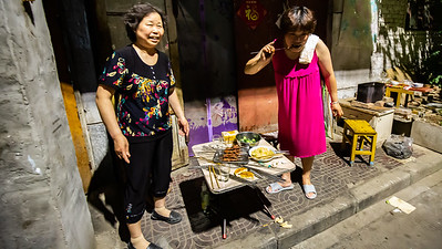 These two ladies had a little Chinese BBQ going in front of their apartment. When they saw Linda and I they were insistent that we joined them for some beef kabobs. The shared language was laughter. A narrow ally off of the main roads became an experience of meeting local Chinese living their daily life.