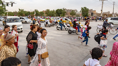 The corner outside the Kashgar market was controlled mayhem as every sort of human conveyance moved with the changing of the lights.