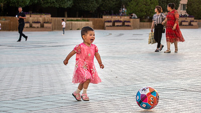 After a few more delicacies at the nightly food market including some sheep's milk ice cream, Linda and I headed over to the plaza in front of the Id Kah Mosque for a little people watching. This joyful little girl and her ball were the highlight of the evening.
