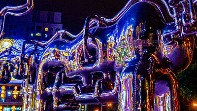 A sculpture of what appeared to be a bull reflecting the lights of a shopping mall.
