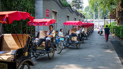 Bicycle rickshaw drivers waiting for fares outside of Beihai Park in Beijing.