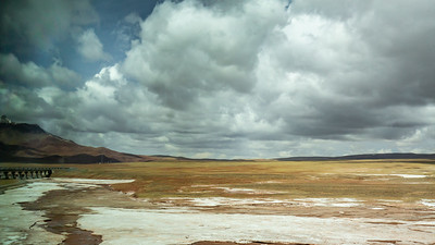 The tundra and permafrost of Tanggula Pass 16,640 ft (5,072 m). The Qinghai-Lhasa segment of 1,200 miles took three years to build due mainly to the difficulties of building over permafrost and the high elevation itself which required hyperbolic pressure chambers for the workers.