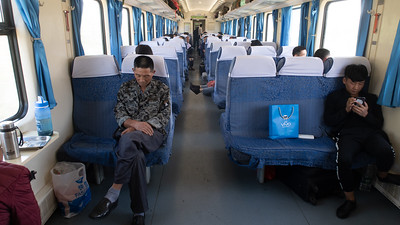 "This a ""hard seat"" carriage on the train to Lhasa.  Does not look to be the most comfortable way to travel."