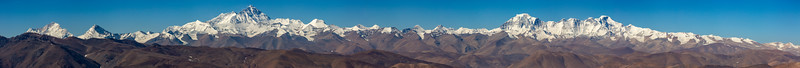 A panorama of 16 photos taken from Pang La Pass 5.205m (17,076ft), one of the highest highway passes in Tibet. Out in the distance are Mt Everest, Cho Oyu, Lhotse, Nuptse and Makalu. Here you can see 4 of the 6 highest peaks in the world as well as 40 over 7,000 m.(23,000 ft). Truly an awe inspiring vista covering 100 km (62 m) of the Himalayas