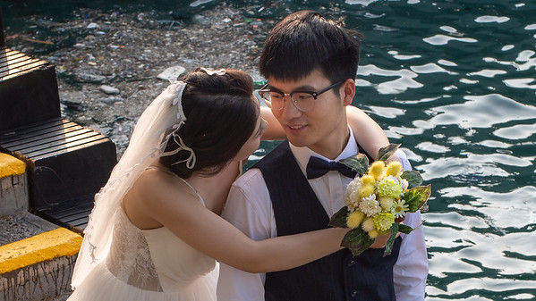 A hobby of mine is taking photos of couples getting their wedding photos taken.  A couple on Hong Kong Harbor.