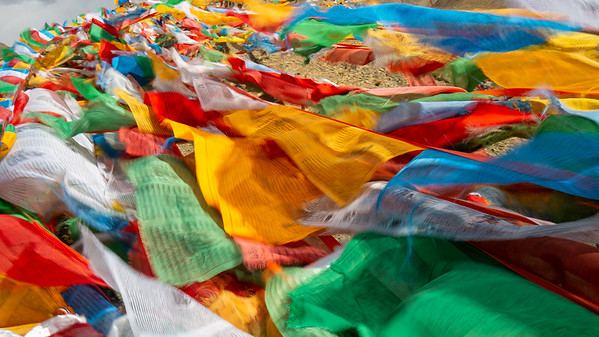 At the top of Karo La Pass, 5,010m (16,500ft) there is a prolific display of prayer flags. Tibetan prayer flags dot the landscape virtually everywhere in Tibet. Prayer flags do not carry prayers to the gods, but rather the prayers printed on the flags are carried on the wind and believed to spread goodwill and positive energy wherever they go.
