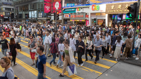 The usual afternoon crowds crossing Nathan Road in downtown Hong Kong.