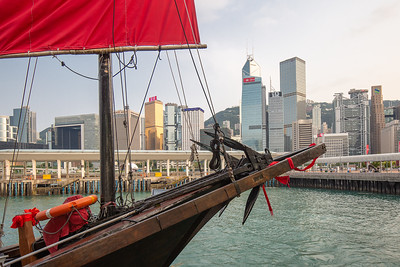 A sanpan with the Hong Kong skyline.