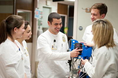 University of Rochester School of Nursing student Victor Hernandez (center) of Cuba, pictured in Strong Memorial Hospital November 28, 2012 with fellow nursing students and instructor Kimberly Augustine (right), is now a Robert Wood Johnson Foundation Scholar in the Accelerated Program for Non-Nurses (APNN) // photo by J. Adam Fenster / University of Rochester