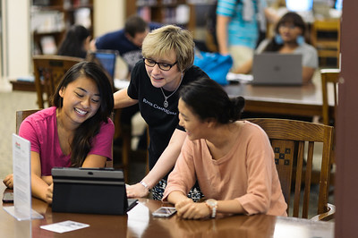 In this photo from left to right, University of Rochester senior Susie Zhang, personal librarian Jennifer Bowen, and University of Rochester senior Nancy Yi, in Rush Rhees Library.   Photo by Brandon Vick, University Communications http://www.rochester.edu