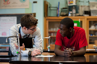Sean Coffey (L), a biology teacher at John Marshall High School, works with senior Craig Stanford of Rochester during a lab on enzymes November 17, 2011. Coffey, a 2009 University of Rochester Warner School graduate currently pursuing his Ph.D. there, is a recipient of a Noyce Scholarship, granted to talented math and science majors who commit to teaching in Rochester City Schools. //photo: J. Adam Fenster / University of Rochester
