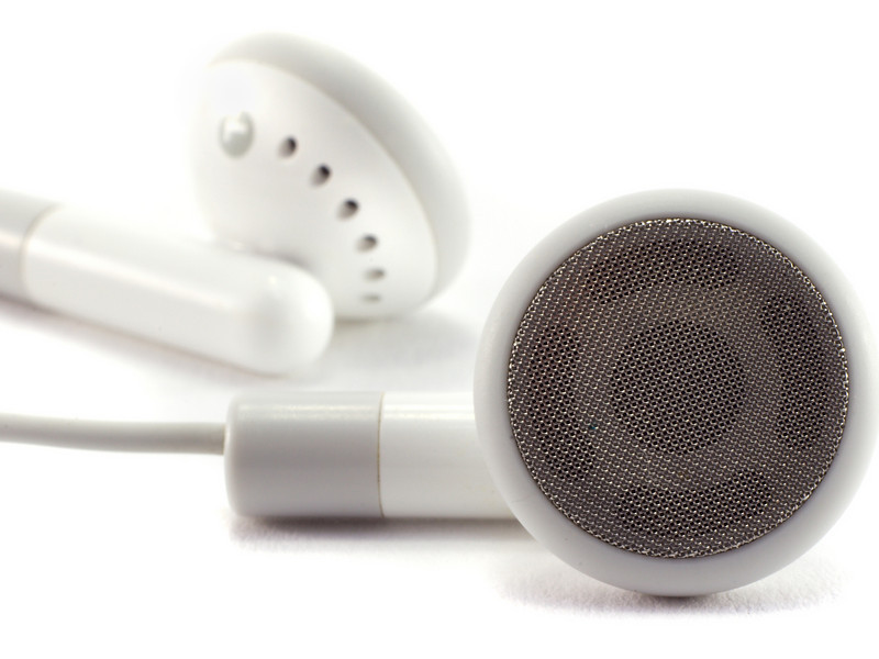 Modern portable audio earphones, isolated on a white background.