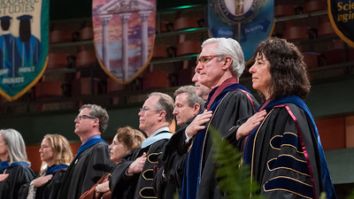 Members of the platform party stand during the National Anthem during the President's Investiture Ceremony during Inauguration Weekend on Friday, March 2nd, 2018 at Texas A&M University - Corpus Christi.