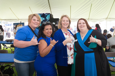 Claire Snyder (left), Leticia Flores, Kelly Quintanilla, and Amy Sanford. Pose for a photo at  the 2018 Inauguration President's Picnic. Friday March 2, 2018 at Texas A&M University-Corpus Christi.