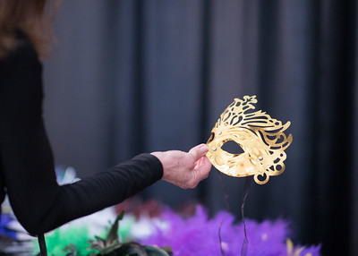 A guest picks out a Mardi Gras mask during President's Ball on March 3rd, 2018 at Texas A&M University - Corpus Christi.