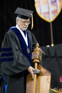Carrier of the mace Dr. Philip Rhoades. Over 1,100 graduates received their degrees during two commencement ceremonies held on May 13.