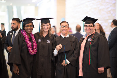Shalecia Sales (left), Alison Sprosty, Son Tran, and Matthew Studlar. Over 1,100 graduates received their degrees during two commencement ceremonies held on May 13.