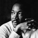Atlanta, Georgia, USA --- Martin Luther King Jr. listens at a meeting of the SCLC, the Southern Christian Leadership Conference, at a restaurant in Atlanta. The SCLC is a civil rights organi ...