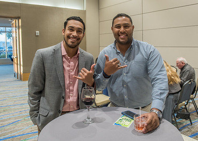 Ben Lopez (left) and Andrei Dennis show islander pride while posing for a quick photo during the VIP reception of the Fall 2017 Distinguished Speaker Series.