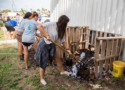 Students churning the compost piles.