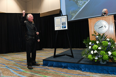 President Emeritus Dr. Robert Furgason gifts State Rep. Todd Hunter with aerial photos of Texas A&M University-Corpus Christi showing the University in 1971 and the other in 2016.