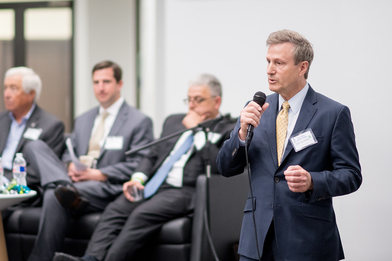"""Dr. John Gamble, Dean of the College of Business, introduces panelists during the Innovation Center's Small Business Week event, """"How to run a successful family business."""""""