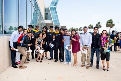 Graduates and their guests gather outside of the American Bank Center following the TAMU-CC 2018 Summer Commencement.
