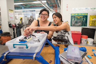Gypsie Alvarado (left), and Arianne Anes work on their Aqua Bat capstone project in the engineering lab.
